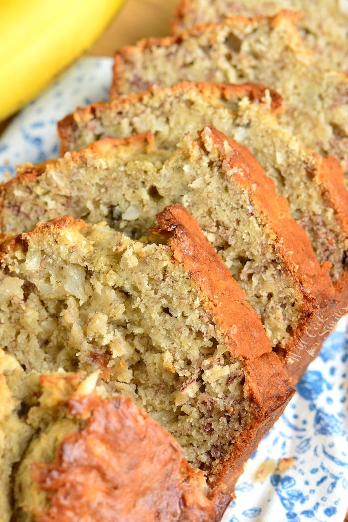 Coconut Banana Bread. Soft, moist, and super easy banana bread made with tropical flavor addition of coconut. This delicious bread makes a great snack. #bread #sweetbread #easybread #bananabread #quickbread #coconut