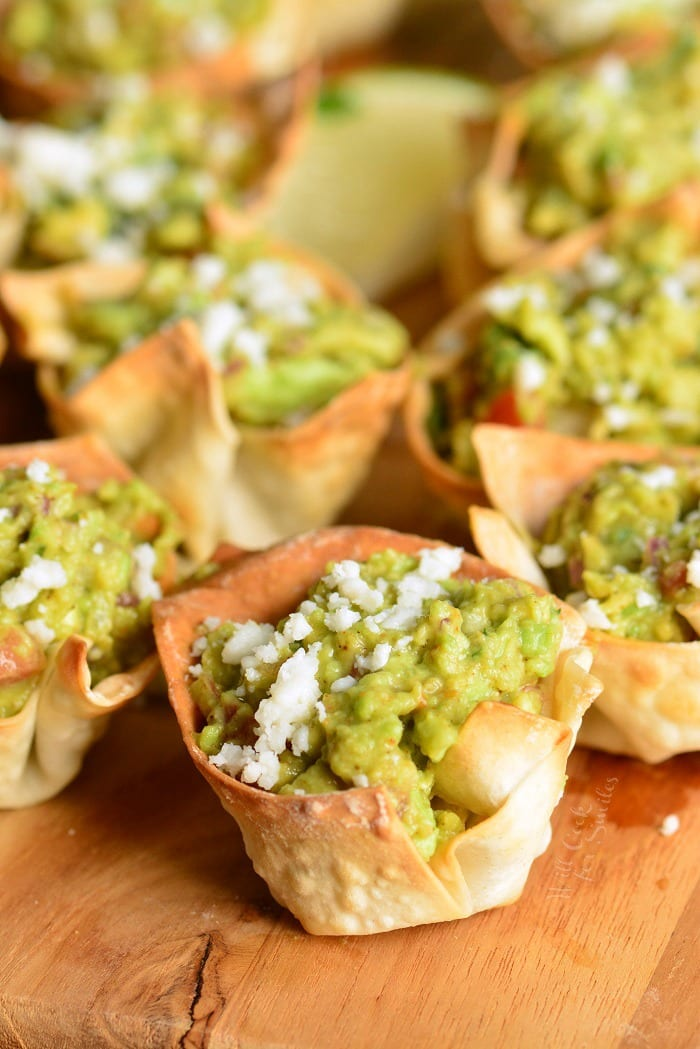 Guacamole in Crispy Cups. Simple and tasty party appetizer. They are made with wonton wrappers, filled with homemade guacamole and topped with crumbled Cotija cheese. #appetizer #snack #avocado #guacamole #individual