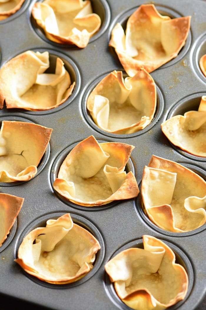 Wonton cups with Guacamole. Simple and tasty party appetizer. They are made with wonton wrappers, filled with homemade guacamole and topped with crumbled Cotija cheese. #appetizer #snack #avocado #guacamole #individual
