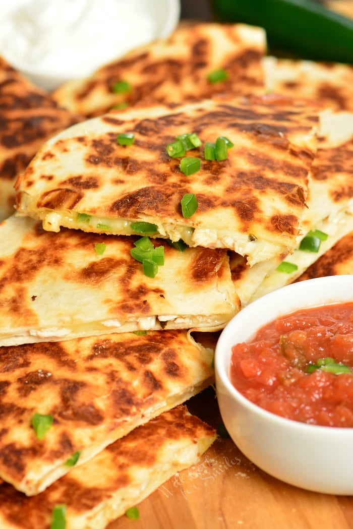 Chicken Quesadillas are easily made with only 4 ingredients and within 30 minutes. This Quesadilla recipe are packed withmelted cheese, tender rotisserie chicken, and spicy jalapenos, all stuffed in a crunchy flour tortilla. #chicken #appetizer #snack #quesadillas