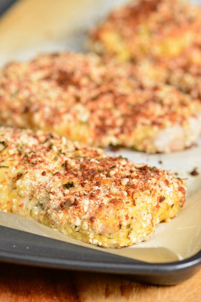 Parmesan Crusted Mahi Mahi on a baking sheet lined with parchment paper