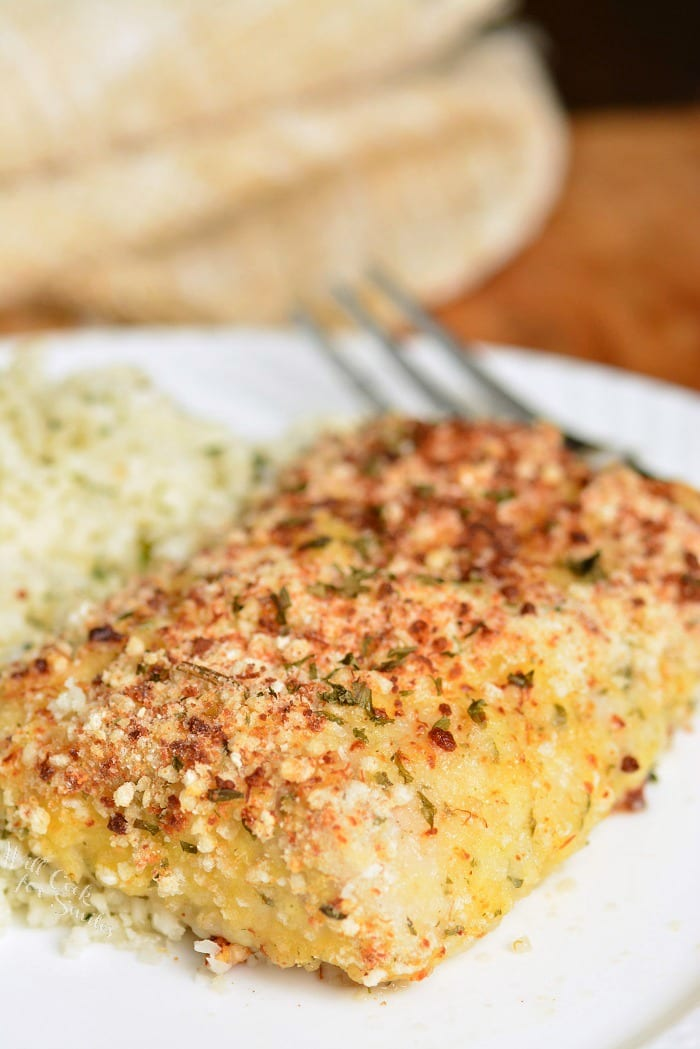 Baked Mahi Mahi. Parmesan Crusted Mahi Mahi is crusted in Parmesan herb coating and easily prepared in the oven and only takes about 10 minutes to prep and 20 minutes to bake. #fish #mahimahi #bakedfish #easydinner