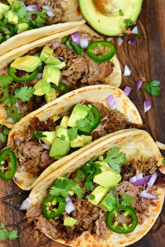 Carnitas is amazingly flavorful Mexican pulled pork made with aromatic spices, vegetables, and citrus. This pork carnitas are easily made in an Instant Pot in just a little oven an hour and comes out so juicy, soft, and tender. #pork #pulledpork #carnitas #tacos