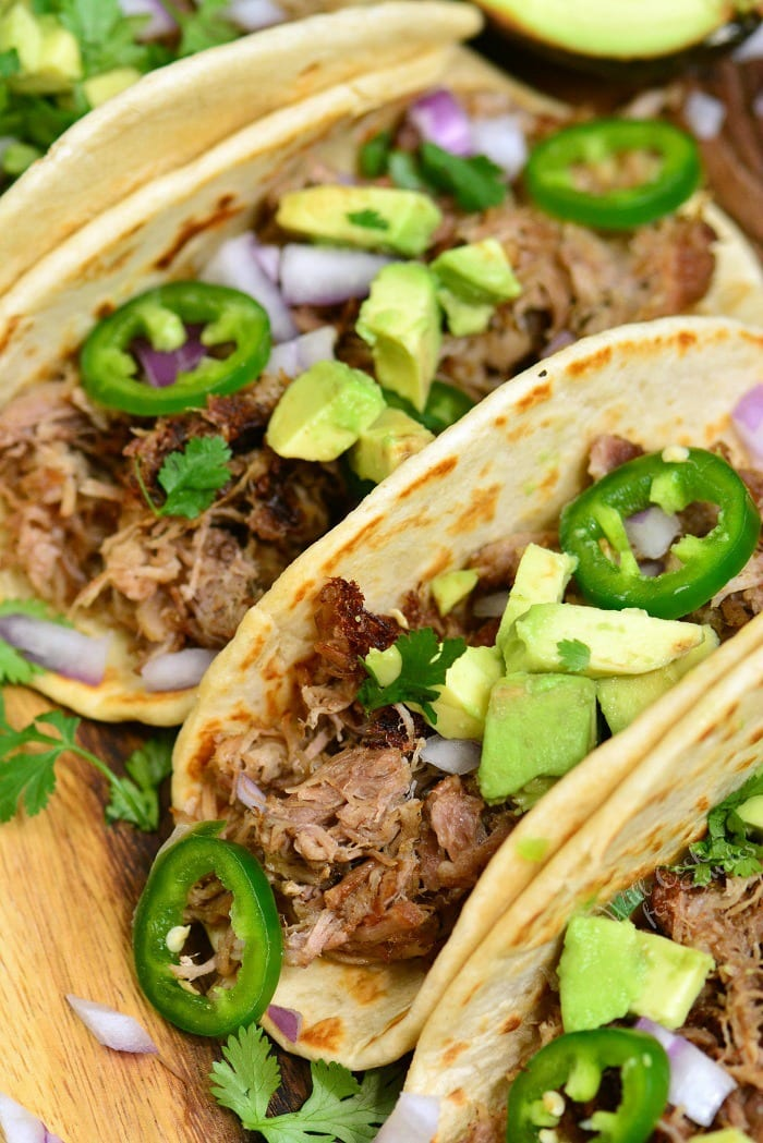 Pork Carnitas is amazingly flavorful Mexican pulled pork made with aromatic spices, vegetables, and citrus. This pork carnitas are easily made in an Instant Pot in just a little oven an hour and comes out so juicy, soft, and tender. #pork #pulledpork #carnitas #tacos