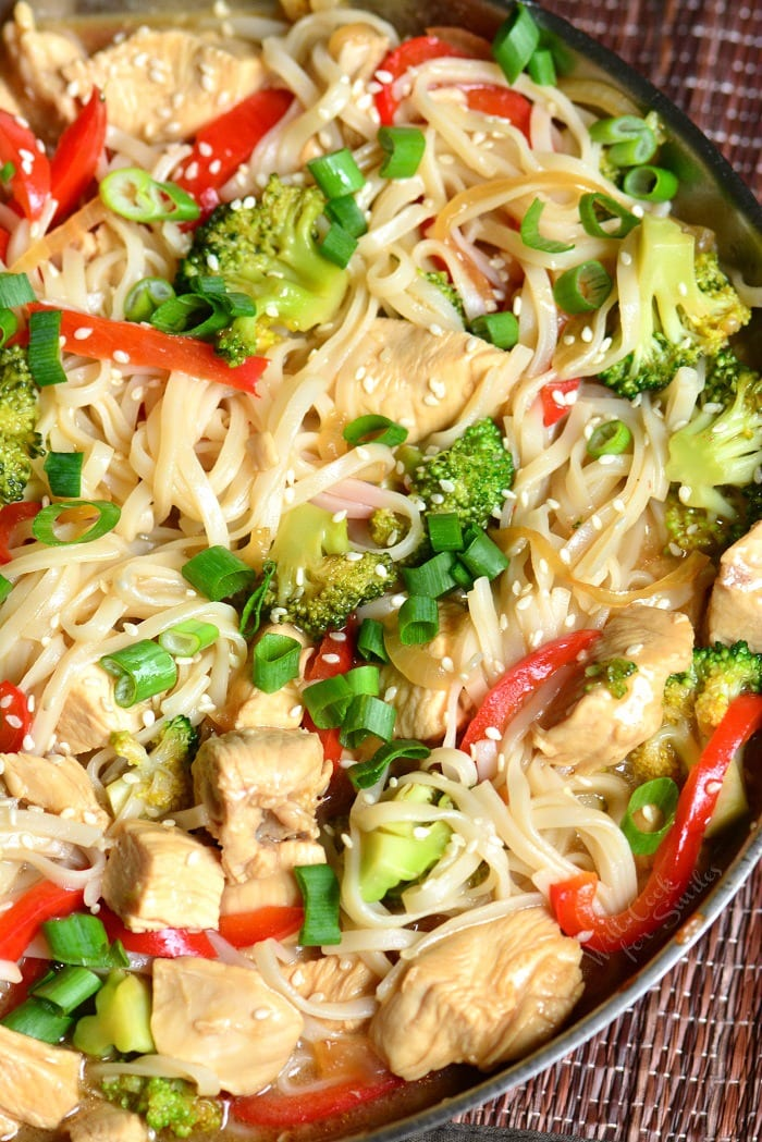 Sesame Chicken with Noodles is a light and easy weeknight dinner made with chicken, veggies, and rice noodles, all cooked in a delicious sesame sauce. #chicken #sesame #noodles #sesamechicken #easydinner #weeknightdinner