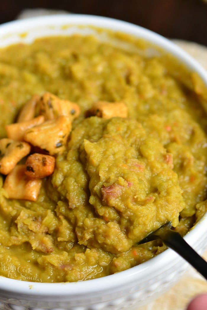 Split Pea Soup. This hearty soup is made with split peas, homemade stock, ham, and vegetables. This pea soup is made extra special by addition of smoked pork neck bones. #soup #splitpea #ham #peasoup