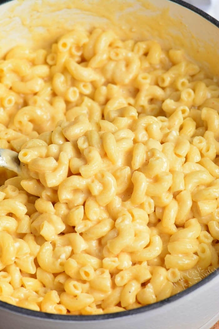 Mac and Cheese Recipe in a pot with a serving spoon