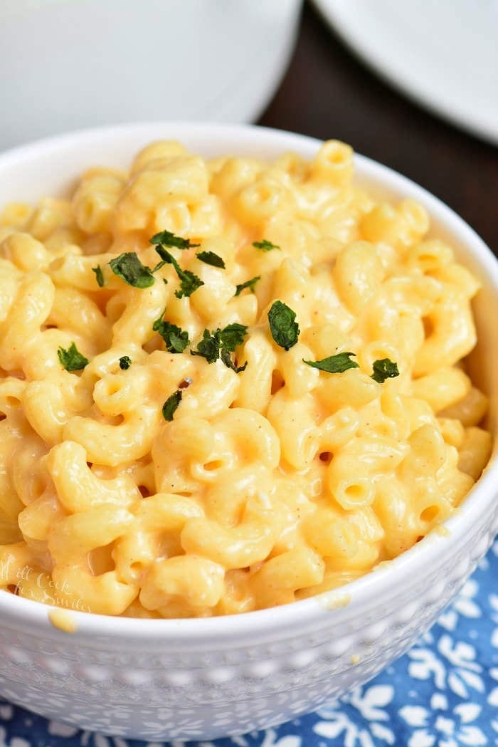 Mac and Cheese Recipe in a bowl on a blue tablecloth