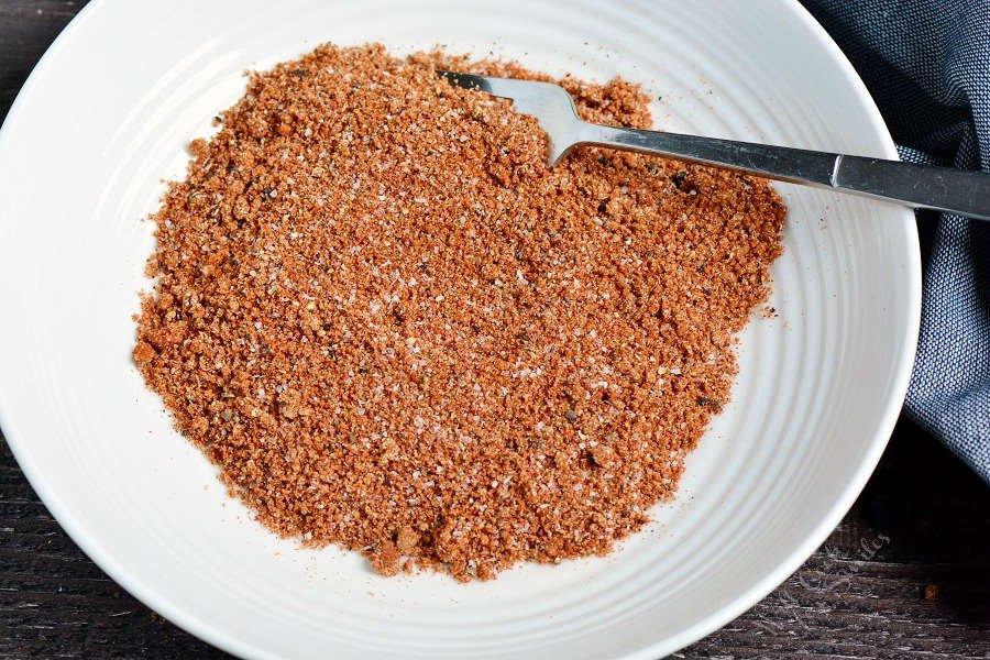 dry rub mixed up in a bowl with a fork