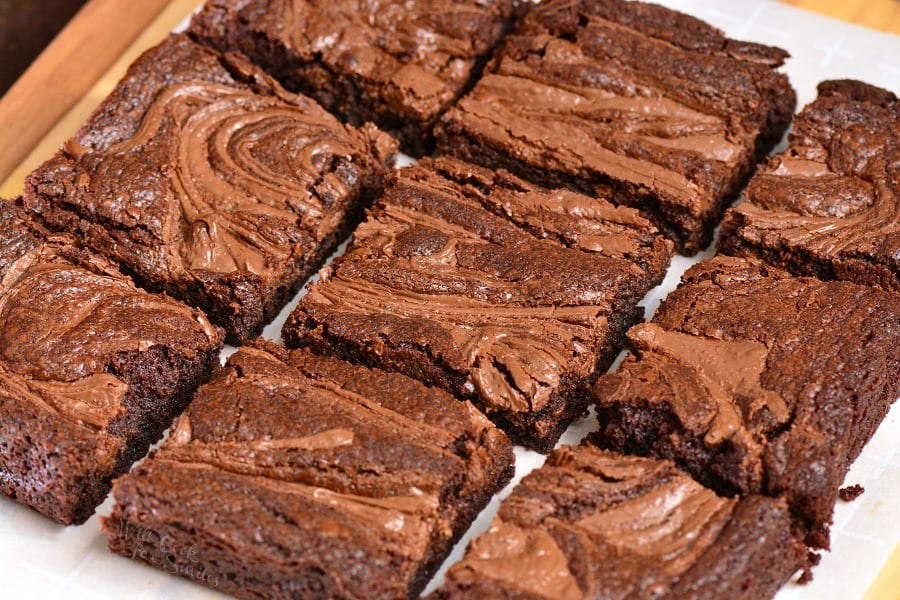 Nutella Brownies. These amazing easy brownies get their moist and creamy texture from addition of Nutella chocolate spread right in the brownies batter and some extra spread over the top. #chocolate #dessert #nutella #brownies