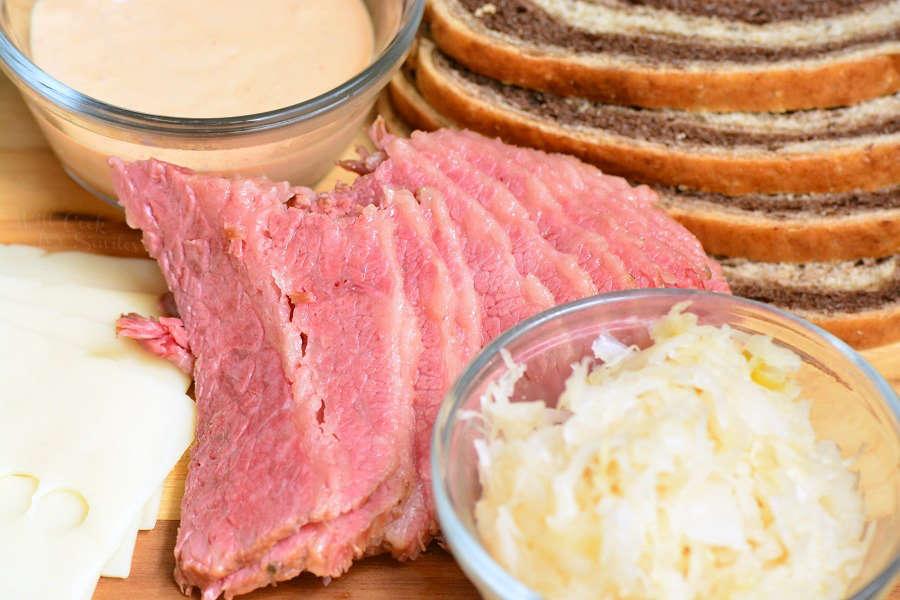 ingredients for ruben sandwich on cutting board