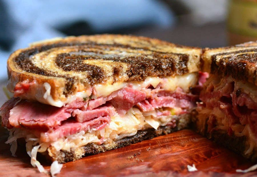 Reuben Sandwich. Perfect combination of warm corned beef, melted Swiss cheese, sauerkraut, Thousand Island dressing, and crunchy rye bread. #cornedbeef #reuben #sandwich #grilledcheese