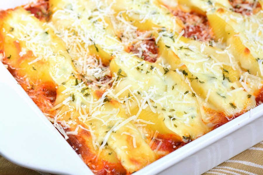Stuffed Shells made with flavorful three cheese ricotta filling and homemade marinara sauce. This stuffed shells recipe is extra cheesy and made with fresh herbs and garlic flavors. #pasta #stuffedshells #meatless #ricotta
