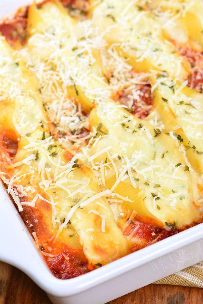 Ricotta Stuffed Shells made with flavorful three cheese ricotta filling and homemade marinara sauce. This stuffed shells recipe is extra cheesy and made with fresh herbs and garlic flavors. #pasta #stuffedshells #meatless #ricotta
