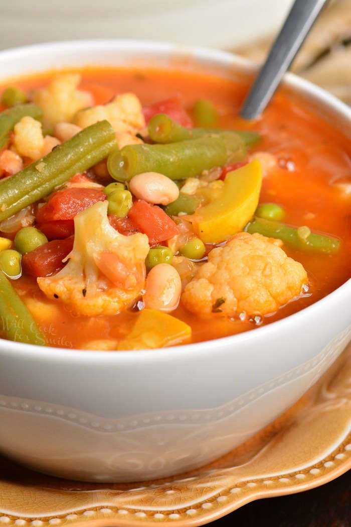 Vegetable Soup is healthy, hearty, and so easy to make in about 30 minutes. This soup is loaded with a lot of fresh vegetables and white beans. #healthy #soup #vegetables #vegetablesoup