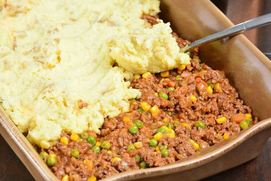 Shepherd's Pie is a comforting casserole that consists of ground beef cooked in gravy with vegetables and topped with mashed potatoes. It's a great comforting recipe that's perfect for making ahead or freezing. #beef #groundbeef #potatoes #casserole
