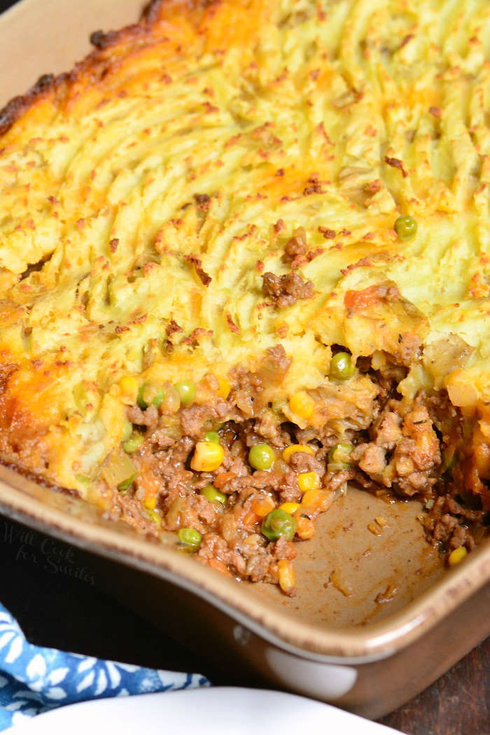 Shepherd's Pie in a casserole dish with a scoop taken out