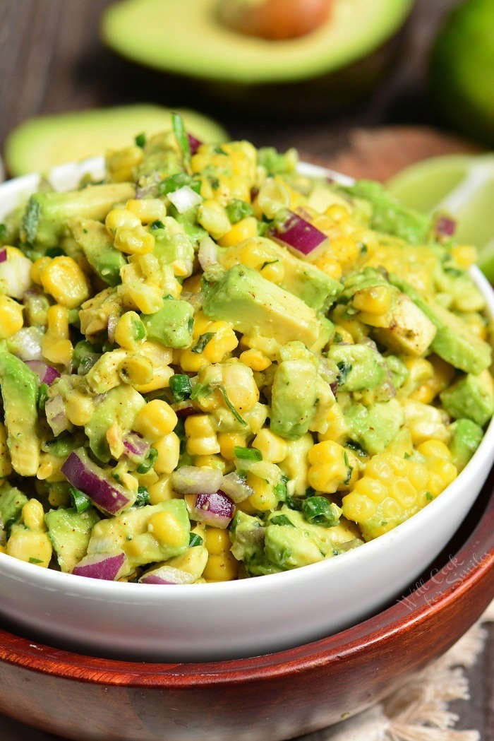 Avocado Corn Salad. This simple salad features corn on the cob, a generous addition of avocado, red onions, scallions, cilantro, and simple seasoning. So much flavor but only a few ingredients.