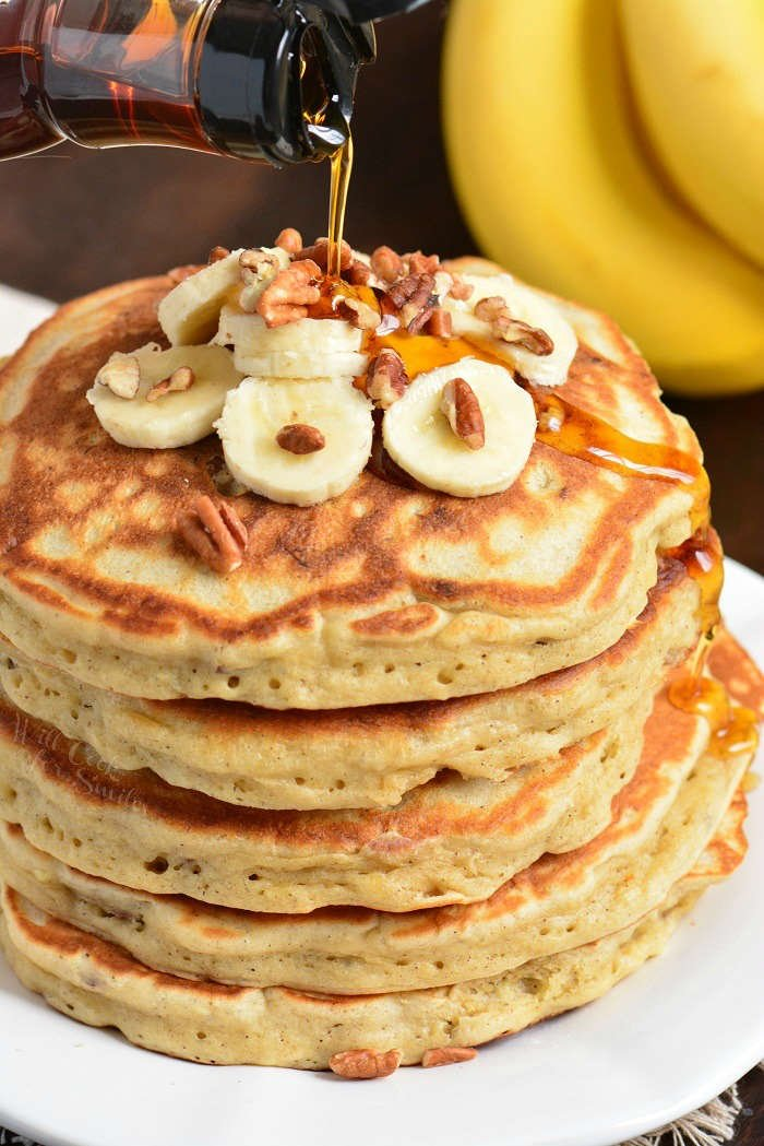 Homemade Pancakes. Soft and fluffy pancakes made with mashed bananas, cinnamon, and nuts. Perfect recipe to use up over-ripe bananas. #breakfast #pancakes #banana
