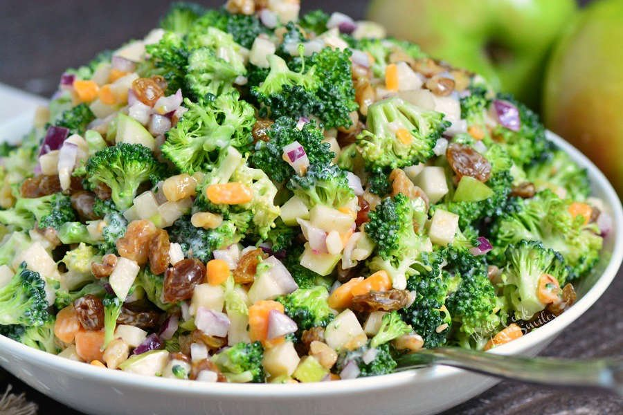 The BEST Broccoli Salad. This broccoli salad is made with apples, walnuts, raisins, cheese crumbles, and red onions. A perfect addition to picnics, potlucks, and outdoor parties.