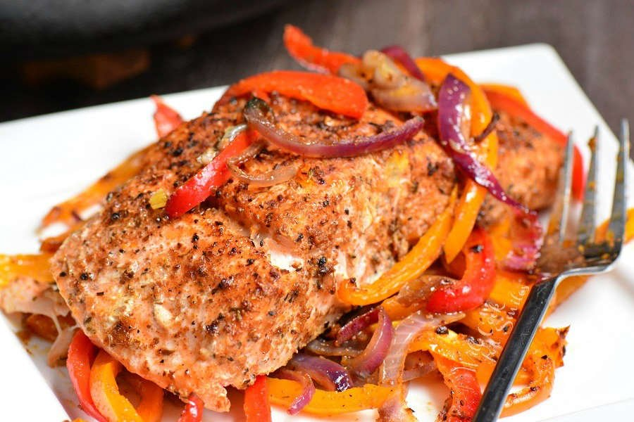 Cajun Salmon. Juicy, fresh salmon is rubbed with Cajun seasoning and baked with bell peppers, garlic, and onions. Serve it with roasted vegetables, over fluffy rice, or quinoa.