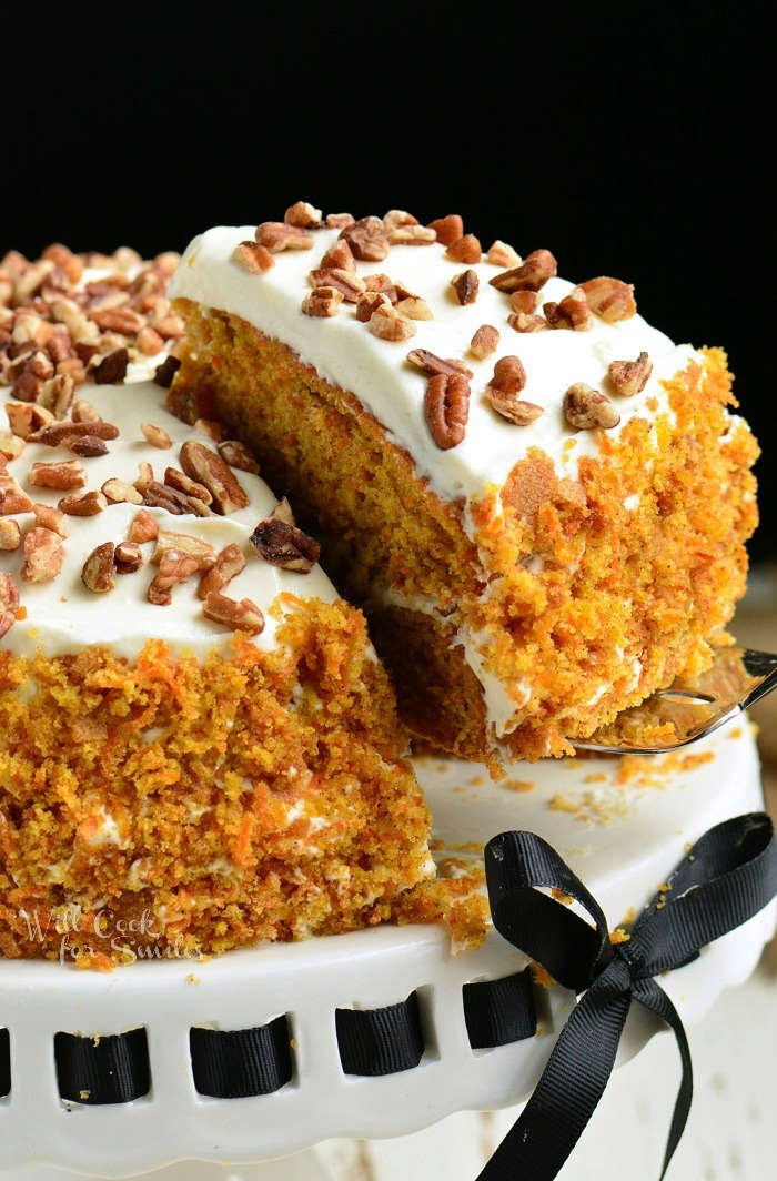 Amazing Carrot Cake recipe. Moist, soft, and flavorful Carrot Cake is packed with freshly grated carrots, nuts, and spices and frosted with smooth cream cheese frosting. #cake #carrotcake #frosting #dessert #creamcheesefrosting