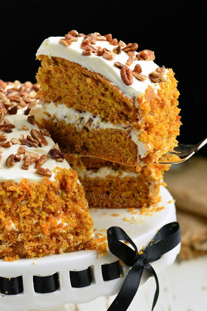 Amazing Carrot Cake. Moist, soft, and flavorful Carrot Cake is packed with freshly grated carrots, nuts, and spices and frosted with smooth cream cheese frosting. #cake #carrotcake #frosting #dessert #creamcheesefrosting