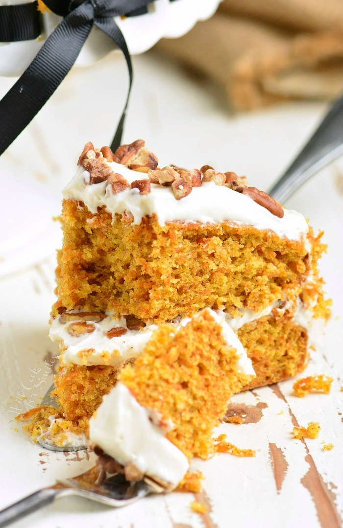 Carrot Cake recipe. Moist, soft, and flavorful Carrot Cake is packed with freshly grated carrots, nuts, and spices and frosted with smooth cream cheese frosting. #cake #carrotcake #frosting #dessert #creamcheesefrosting