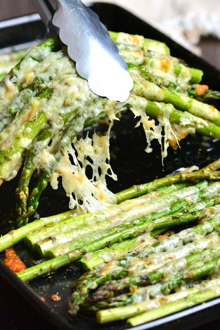 Easy Roasted Asparagus is a simple side dish that will be ready in less than 20 minutes. It's made with addition of Italian flavors like oregano, parsley, and Parmesan cheese.