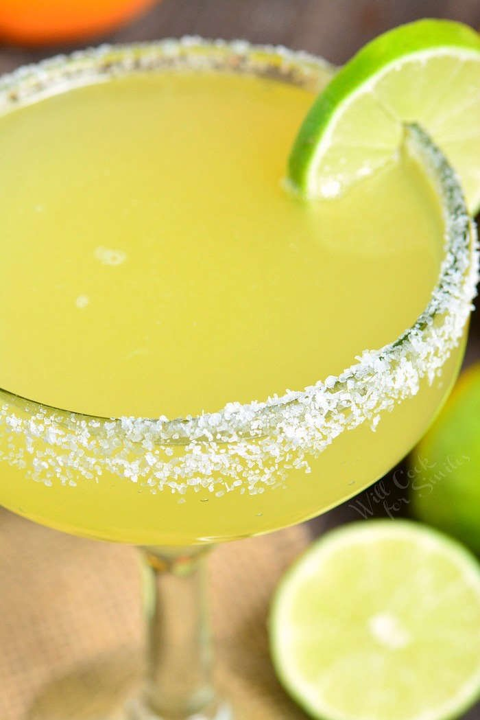 close up of margarita in a glass with salted rim