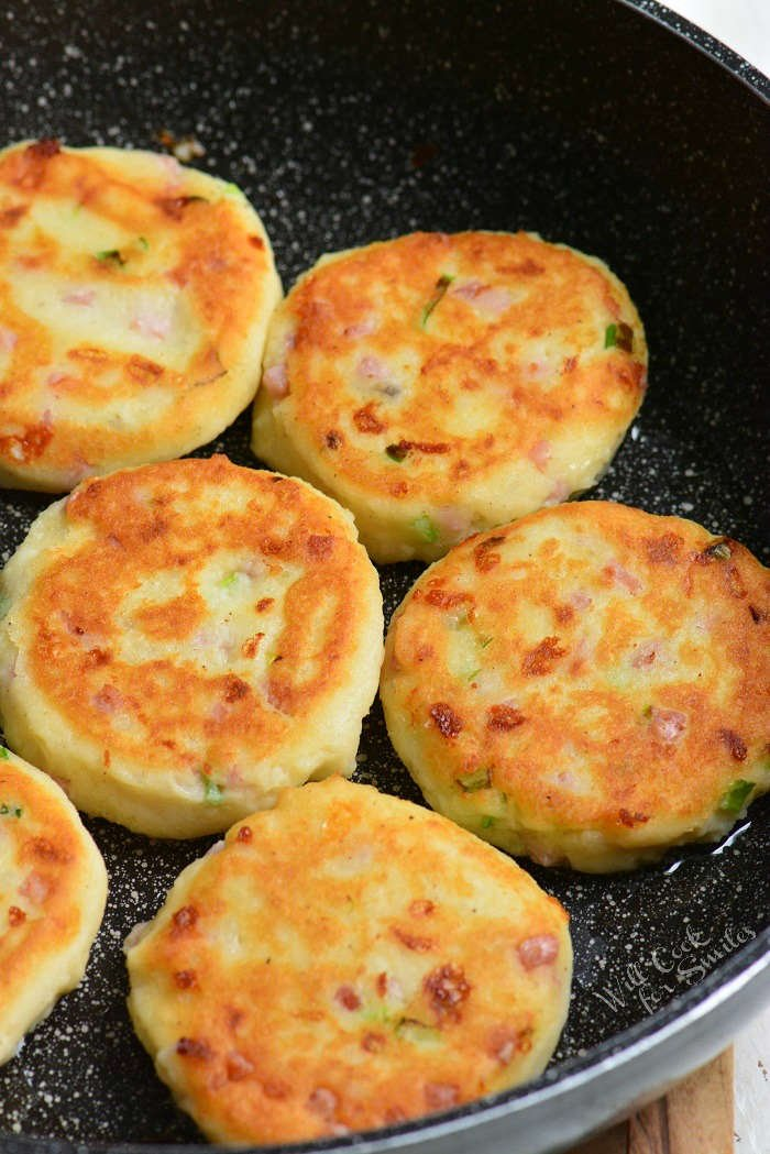 Ham and Cheese Mashed Potato Cakes being cooked in a pan
