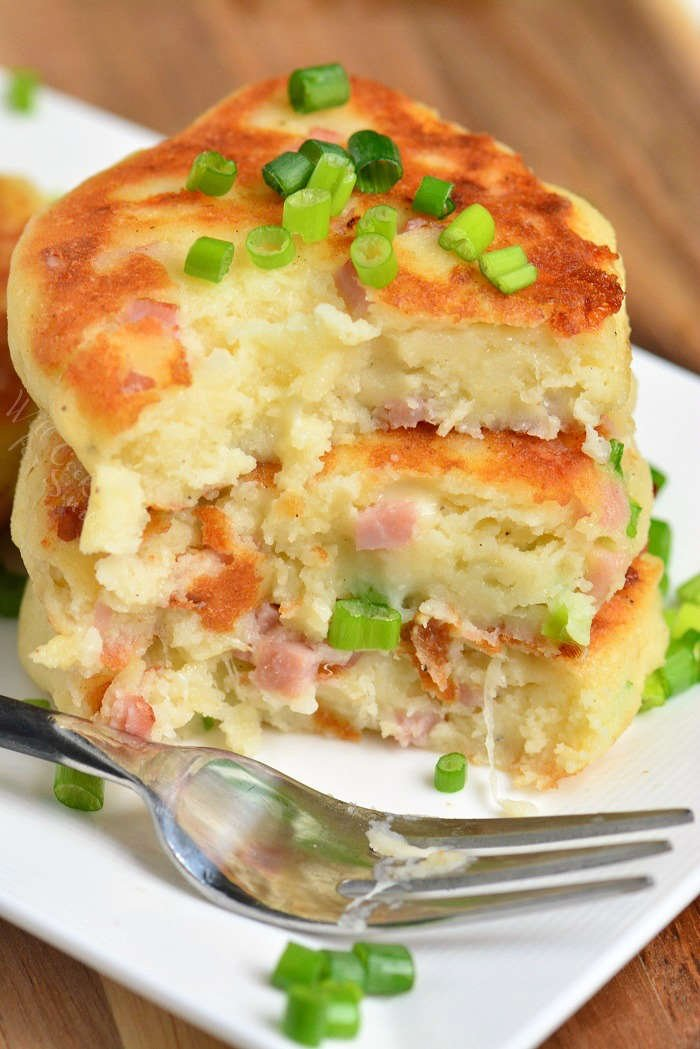 Easy Mashed Potato Cakes on a serving plate with a fork