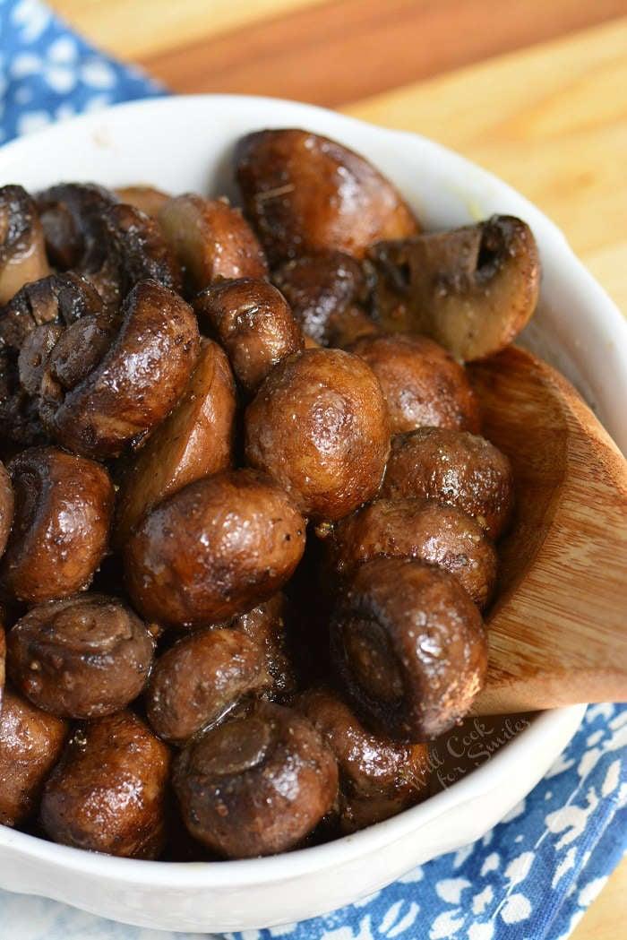 Roasted Mushrooms. Firm, meaty crimini mushrooms are simply seasoned, roasted until tender, and tossed lightly with butter and garlic mixture. #mushrooms #sidedish #roastedmushrooms #easysides