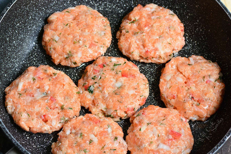 Shape salmon patties (image of uncooked salmon patties in a pan.)