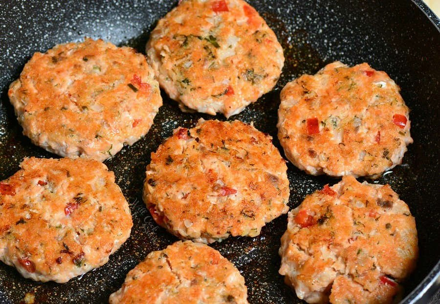 Cook salmon patties for about 7 minutes on each side (image of cooked salmon patties in a pan.)