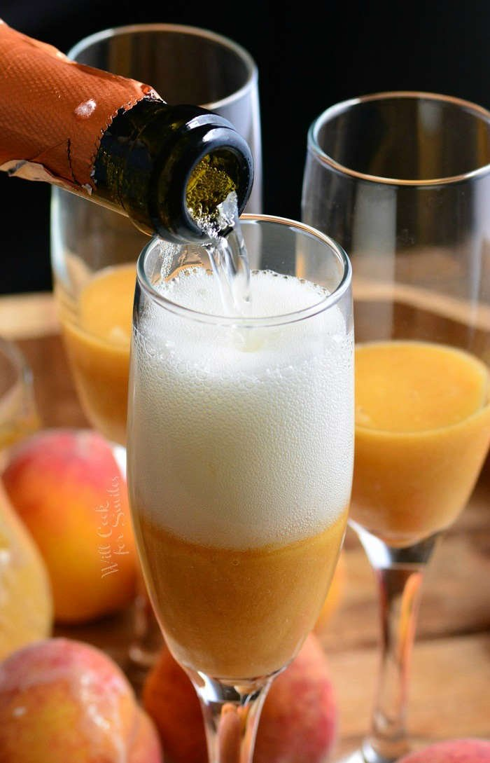 pouring Prosecco in Peach Bellini in a champagne flute