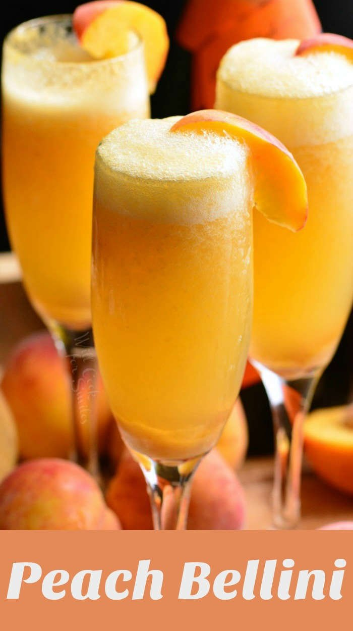 Bellini in champagne classes with a peach garnish