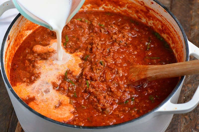 When to add milk to Bolognese sauce? About half way through cooking.