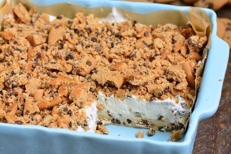 Cookie Dough No Bake Cheesecake in a pan with slice missing