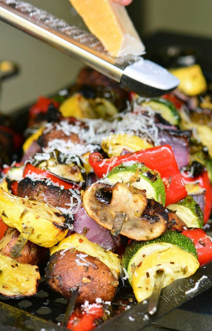 grating cheese over Grilled Vegetables with Italian flavors
