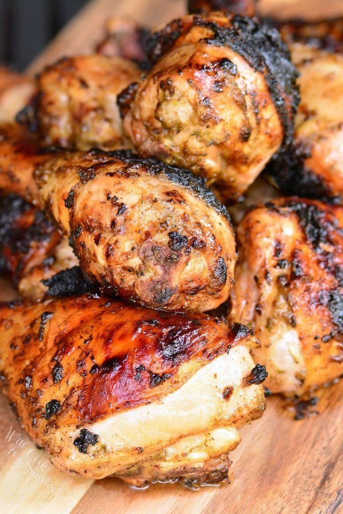 Jerk Chicken piled together on a wood cutting board