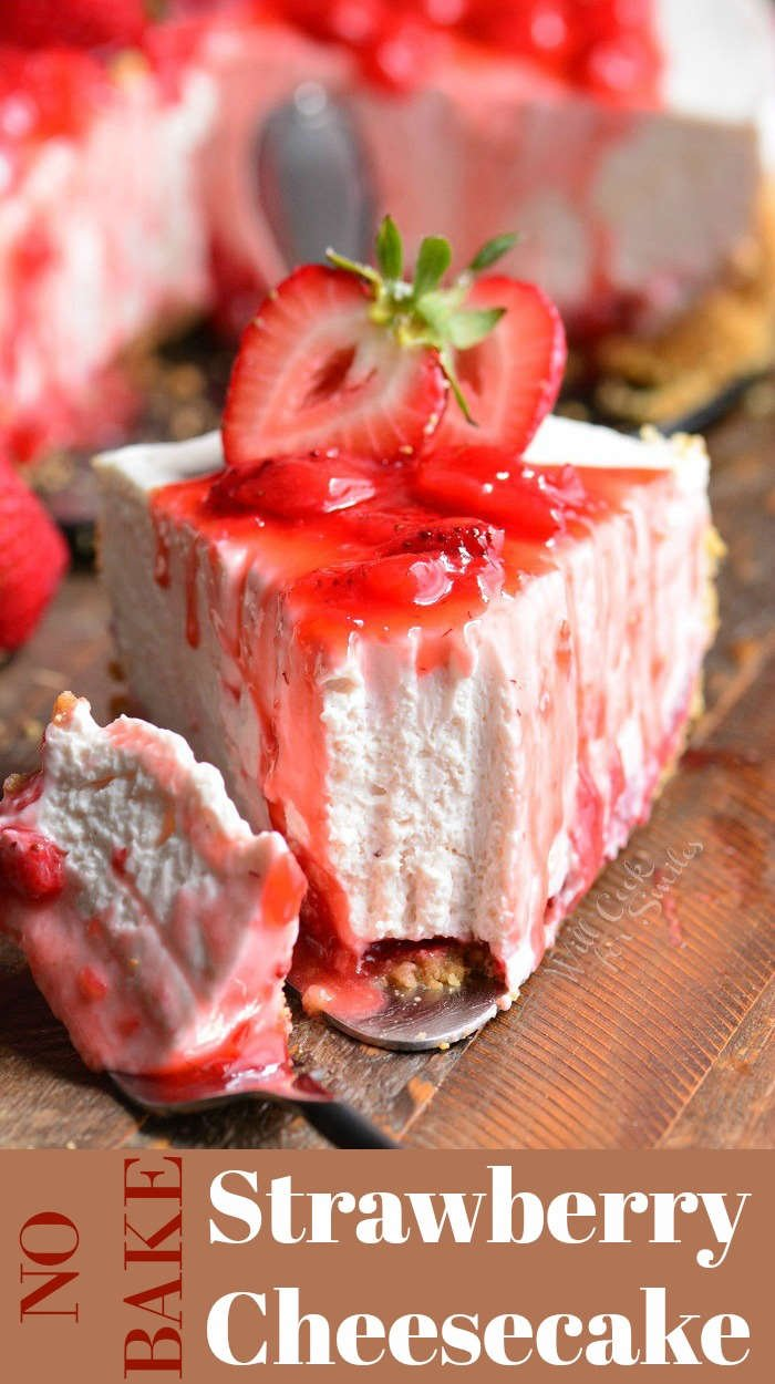 Strawberry No Bake Cheesecake slice on wood cutting board