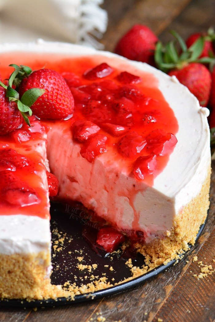 Homemade Strawberry No Bake Cheesecake with a piece missing.