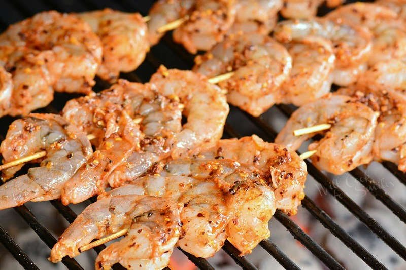 Cooking shrimp on skewers on the grill