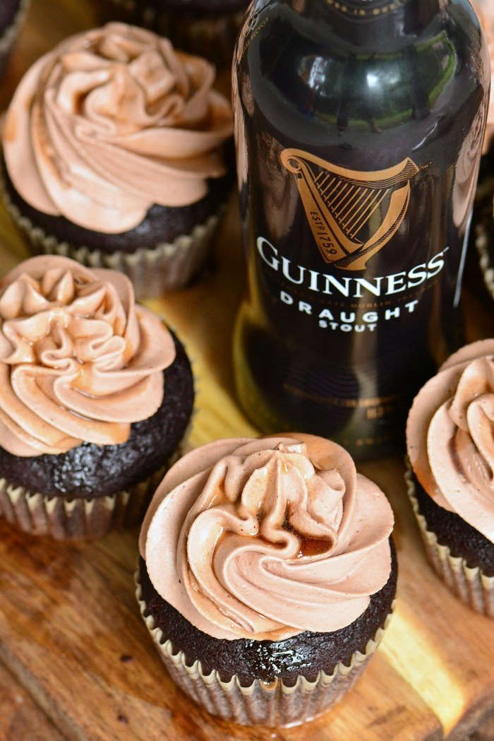 chocolate stout cupcakes with Guinness beer on wood cutting board