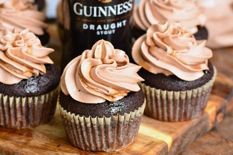 chocolate stout cupcakes on wood cutting board with bottle of stout beer