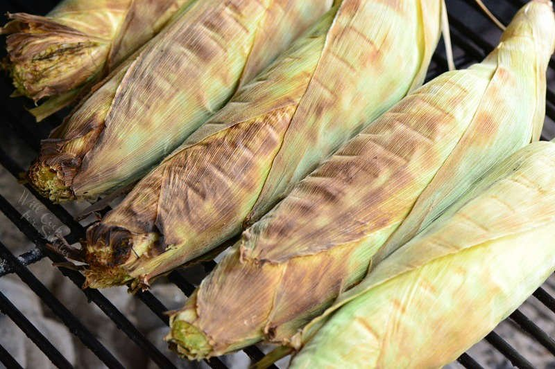 Corn on the cob in husks on the grill