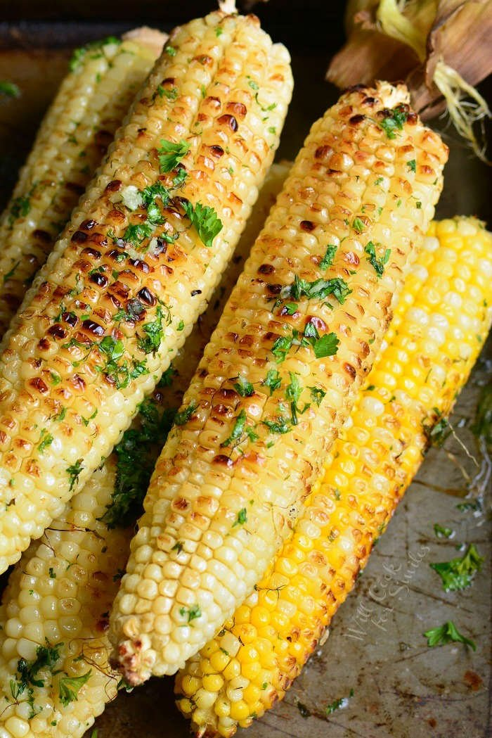 grilled corn on the cob on a baking sheet