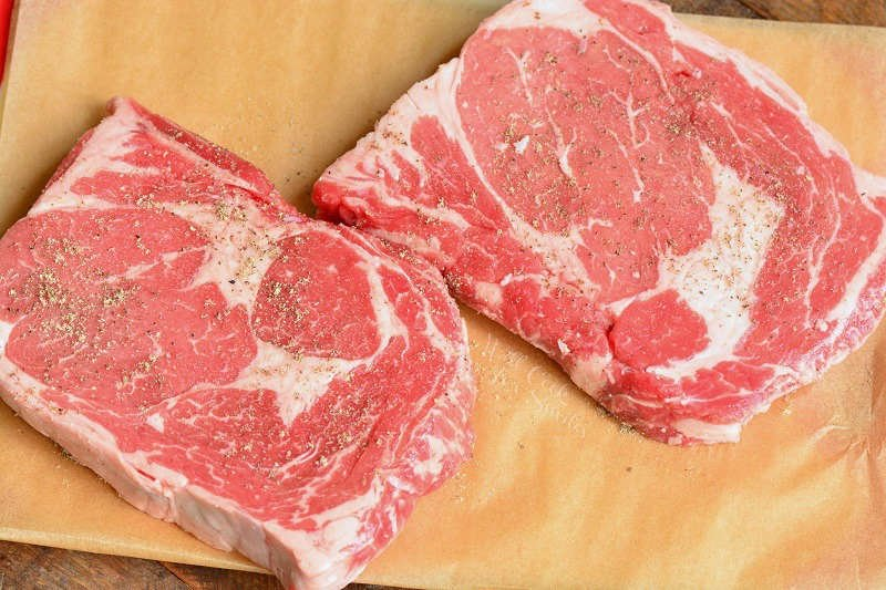 raw rib eye steaks