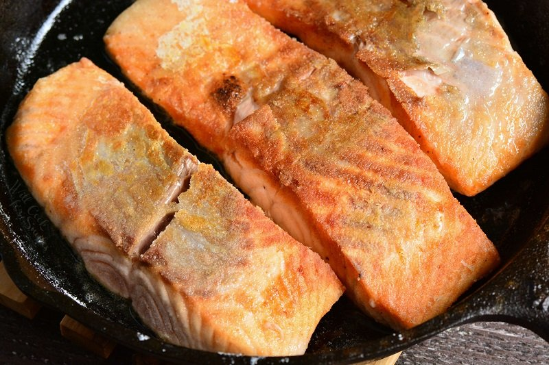 cook salmon in a skillet for 4-5 minutes on each side